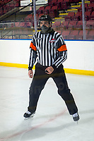 KELOWNA, BC - MARCH 29: Referee Josh Albinati stands on the ice for his first game as a referee at Prospera Place on March 29, 2021 in Kelowna, Canada. (Photo by Marissa Baecker/Shoot the Breeze)