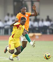 Photo: Steve Bond/Richard Lane Photography.<br />Ivory Coast v Benin. Africa Cup of Nations. 25/01/2008. Ahoueya Jocelin (front) gets in front of Yaya Toure