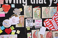 Children's drawing and messages of support cover hte Marcus Rashford mural at the unveiling event at Withington, Manchester, United Kingdom on 17 July 2021.