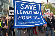 London, UK. Saturday 18th May 2013. Protestors march in a demonstration against NHS reform and proposed funding cuts for services within the National Health Service. Banner to save Lewisham Hospital.