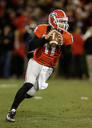 ATHENS, GA - NOVEMBER 23:  Quarterback Aaron Murray #11 of the Georgia Bulldogs rolls out and looks downfield during the game against the Kentucky Wildcats at Sanford Stadium on November 23, 2013 in Athens, Georgia.  (Photo by Mike Zarrilli/Getty Images)