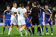 Cardiff City's Fabio Da Silva (next to ref left) argues with the Hull City players as a scuffle breaks out leading to Da Silva getting booked. . Skybet football league championship match, Cardiff city v Hull city at the Cardiff city stadium in Cardiff, South Wales on Tuesday 15th Sept 2015.<br /> pic by Carl Robertson, Andrew Orchard sports photography.