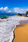 Rocks and surf at Hanakapi'ai Beach along the Kalalau Trail, Na Pali Coast, Island of Kauai, Hawaii