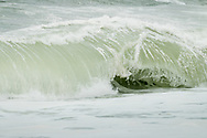 A wave curls in on itself along the backside beach at Provincetown.