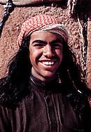 Young bedouin man competing in the annual camel race at Jinayderiah, near Riyadh, Saudi Arabia