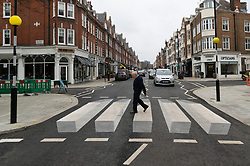 © Licensed to London News Pictures. 01/03/2019. London, UK.  A pedestrian walks across the UK's first 3D zebra crossing in St Johns Woord, North London in a bid to slow down the traffic.The optical illusion, which creates a floating effect, has been introduced in St John's Wood by Westminster City Council as part of a 12-month trial. Photo credit: Ray Tang/LNP