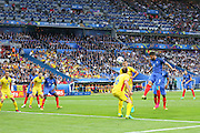 France Forward Olivier Giroud heads at goal during the Group A Euro 2016 match between France and Romania at the Stade de France, Saint-Denis, Paris, France on 10 June 2016. Photo by Phil Duncan.
