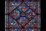 Medieval Windows of the Gothic Cathedral of Chartres, France- dedicated to Joseph the Patriach .  Central panel - bottom Angry that Joseph spurned her, Potiphar's wife accuses him of attempted rape , left - Convinced by his wife's calumny, Potiphar has Joseph arrested , right - Joseph is thrown into prison , top - Pharaoh asleep in his palace, dreaming . A UNESCO World Heritage Site. .<br /> <br /> Visit our MEDIEVAL ART PHOTO COLLECTIONS for more   photos  to download or buy as prints https://funkystock.photoshelter.com/gallery-collection/Medieval-Middle-Ages-Art-Artefacts-Antiquities-Pictures-Images-of/C0000YpKXiAHnG2k