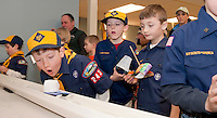 """The 2nd annual Rain Gutter Regatta for Boy Scout pack 243 brought a flurry of """"gutter"""" worthy vessels including Carson Ormes' flying purple catamaran.   (Karen Bobotas/for the Laconia Daily Sun)"""