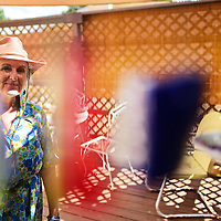 081115  Adron Gardner/Independent<br /> <br /> Artist Mar Heifner peers through a wind chime at her home in Gallup Tuesday.  Heifner will be hosting a show for her work in Albuquerque this weekend.