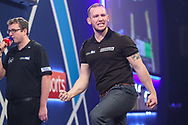 Arron Monk hits a double and wins a leg and celebrates during the PDC William Hill World Darts Championship at Alexandra Palace, London, United Kingdom on 15 December 2019.