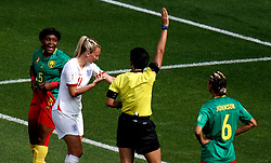 England's Toni Duggan (second left) reacts and shows match referee Qin Liang after she is spat on by by Cameroon's Augustine Ejangue (left) during the FIFA Women's World Cup, round of Sixteen match at Stade du Hainaut, Valenciennes.