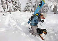 Abbie Bilotta hikes up to the top of Telemark Bowl with her dog, Shasta, on Sunday morning.  Dozens of skiers and snowboarders packed the Teton Pass parking area to take advantage of the first major snow accumulation of the season.