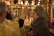 Moscow, Russia, 01/01/2005..Father Vasilii conducts New Year's Day service in Peter Paul church in Lefortovo..
