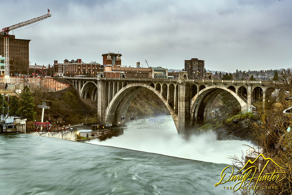 The beautiful Monroe Street Bridge spanning the, brimming with spring flow, Spokane River in downtown Spokane Washington.