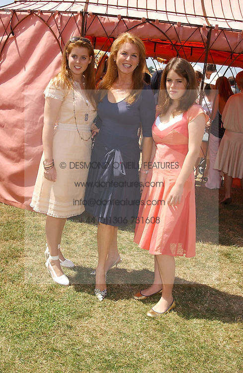 Left to right, HRH PRINCESS BEATICE OF YORK, SARAH, DUCHESS OF YORK and HRH PRINCESS EUGENIE OF YORK at the Veuve Clicquot sponsored Gold Cup Final or the British Open Polo Championship held at Cowdray Park, West Sussex on 17th July 2005.<br /><br />NON EXCLUSIVE - WORLD RIGHTS