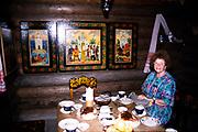 Inside tea house cafe at Dagomys Tea Plantation, Sochi, Russia woman sitting set table 1997