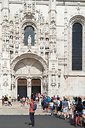 Tourists queue at Church of Santa Maria, Monastery of Jeronimos - Mosteiro  dos Jeronimos in Lisbon, Portugal