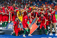 Portugal forward Cristiano Ronaldo (7) holds the trophy in front of his team mates building anticipation with the fans after winning the UEFA Nations League match between Portugal and Netherlands at Estadio do Dragao, Porto, Portugal on 9 June 2019.