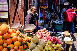 A stallholder selling fruit from his stall in the medina in Marrakech, Morocco, North Africa<br /> <br /> <br /> <br /> (c) Andrew Wilson | Edinburgh Elite media