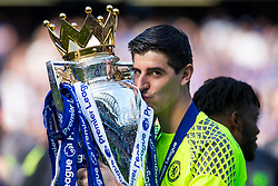 Thibaut Courtois kisses the trophy as Chelsea celebrate winning the 2016/17 Premier League - Rogan Thomson/JMP - 21/05/2017 - FOOTBALL - Stamford Bridge - London, England - Chelsea v Sunderland - Premier League..