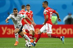 June 19, 2018 - Saint Petersburg, Russia - Abdalla Said (L) of the Egypt national football team and Alexander Samedov of the Russia national football team vie for the ball during the 2018 FIFA World Cup match, first stage - Group A between Russia and Egypt at Saint Petersburg Stadium on June 19, 2018 in St. Petersburg, Russia. (Credit Image: © Igor Russak/NurPhoto via ZUMA Press)