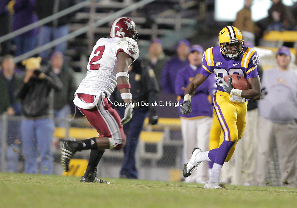 15 November 2008: LSU wide receiver Terrance Toliver (80) runs away from Troy linebacker Boris Lee (2) during the LSU Tigers 40-31 come from behind victory over the Troy Trojans at Tiger Stadium in Baton Rouge, LA.