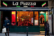 Italian Pizza restaurant on Villiers Street, London. On a cold winter day the interior looks warm inside.