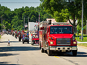 04 JULY 2020 - RUNNELLS, IOWA: during the 4th of July parade in Runnells, a small community about 25 miles from Des Moines. Most of the Independence Day parades in central Iowa were cancelled because of the COVID-19 (Coronavirus) pandemic. People in Runnells made the decision to go ahead with their parade, the first 4th of July parade in the town in recent memory. Most of the people in the parade were farmers, who drove their tractors through the town.     PHOTO BY JACK KURTZ