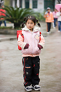 Young girl in the playground of a primary school in Fuli. China has a one child policy to limit population.