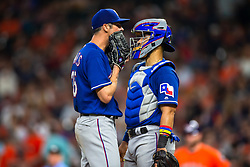 April 13, 2018 - Houston, TX, U.S. - HOUSTON, TX - APRIL 13: Texas Rangers starting pitcher Cole Hamels (35) visits with Texas Rangers catcher Robinson Chirinos (61) on the mound in the sixth inning during an MLB game between the Houston Astros and the Texas Rangers and April 13, 2018 at Minute Maid Park in Houston, TX.  (Photo by Juan DeLeon/Icon Sportswire) (Credit Image: © Juan Deleon/Icon SMI via ZUMA Press)