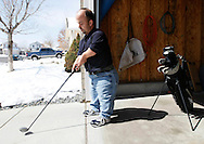 Chris Kotzian demonstates a set of golf clubs custom made for him as a gift from his wife Barb at his home in Thornton, Colorado March 25, 2010.  Chris and Barb are both little persons or achondroplasia dwarfs and are active in the Little People of America, the only dwarfism support organization that includes all 200+ forms of dwarfism.  REUTERS/Rick Wilking (UNITED STATES)