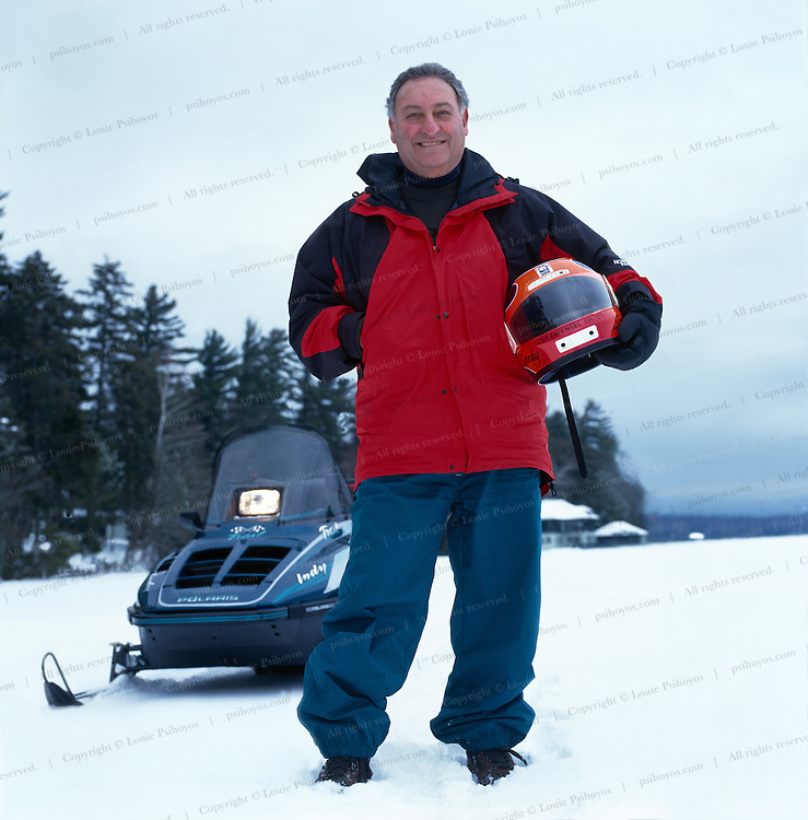 """Sandy Weill, chairman of Citicorp Group at his retreat in Saranac Lake, New York.  """"CUT EXPENSES OR DIE' is written on his helmet.<br /> <br /> Sandy Weil, chairman of Citicorp Group."""