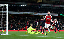 """Arsenal's Olivier Giroud celebrates scoring his side's second goal of the game during the Premier League match at the Emirates Stadium, London. PRESS ASSOCIATION Photo. Picture date: Wednesday November 29, 2017. See PA story SOCCER Arsenal. Photo credit should read: Nigel French/PA Wire. RESTRICTIONS: EDITORIAL USE ONLY No use with unauthorised audio, video, data, fixture lists, club/league logos or """"live"""" services. Online in-match use limited to 75 images, no video emulation. No use in betting, games or single club/league/player publications"""