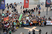Supporters and protesters hold up their banners and placards at the Rise For Climate Change event held outside Tate Modern in London, England, United Kingdom on September 8th 2018. Tens of thousands of people joined over 830 actions in 91 countries under the banner of Rise for Climate to demonstrate the urgency of the climate crisis. Communities around the world shined a spotlight on the increasing impacts they are experiencing and demanded local action to keep fossil fuels in the ground. There were hundreds of creative events and actions that challenged fossil fuels and called for a swift and just transition to 100% renewable energy for all. Event organizers emphasized community-led solutions, starting in places most impacted by pollution and climate change. Photographed for 350.org.