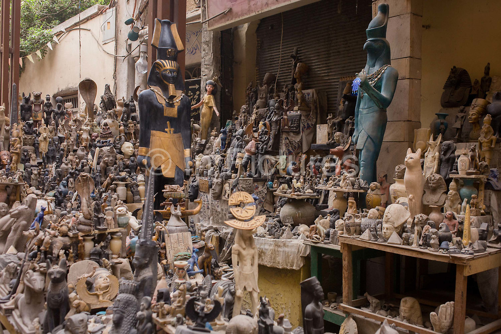 Tourist trinkets and statues in the souk at Luxor, Nile Valley, Egypt. A vast selection of Pharaonic statuettes and figurines are piled up on tables and shelves awaiting visitors to arriave and barter for the prices and deals. The heritage industry and local businesses are obviously very dependent of the tourism industry and therefore badly affected by the downturn. According to the country's Ministry of Tourism, European visitors to Egypt is down by up to 80% in 2016 from the suspension of flights after the downing of the Russian airliner in Oct 2015. Euro-tourism accounts for 27% of the total flow and in total, tourism accounts for 11.3% of Egypt's GDP so communities like this are suffering economically, as a result.