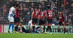 Brighton & Hove Albion's Florin Andone (centre) heads in Brighton's third goal