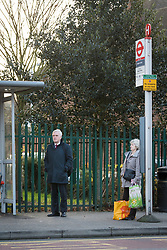 © Licensed to London News Pictures. 22/11/2017. London, UK. JOHN MCDONNELL, Labour Shadow Chancellor waits for a bus as he heads for Parliament on Budget day. Photo credit: Vickie Flores/LNP