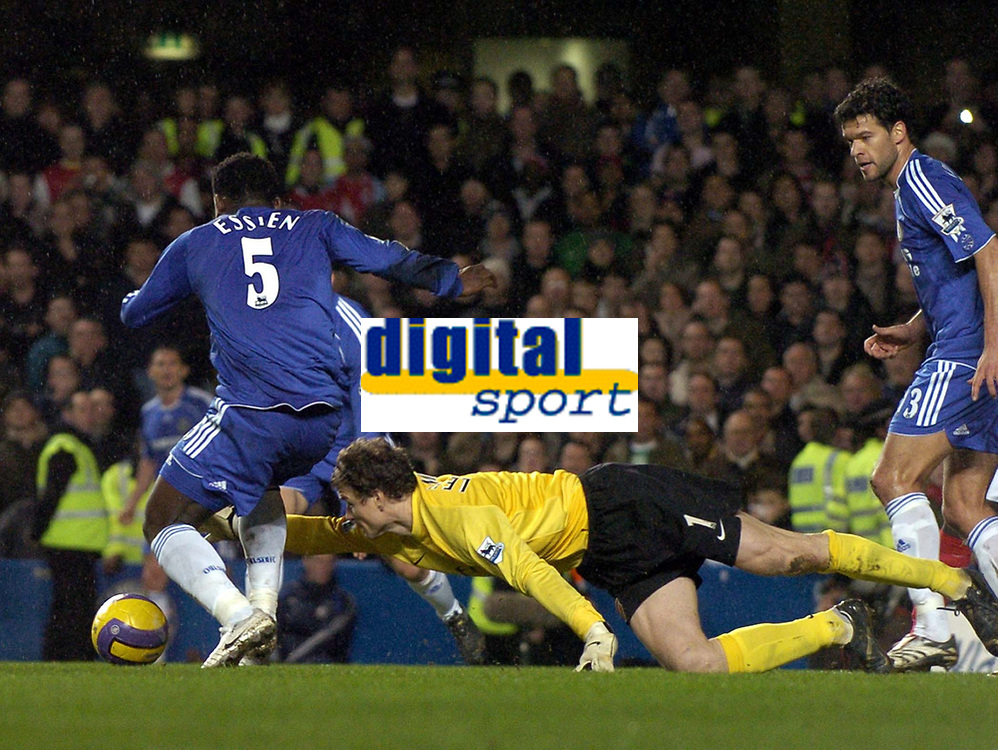 Photo: Olly Greenwood.<br />Chelsea v Arsenal. The Barclays Premiership. 10/12/2006. Chelsea's Michael Essien and Arsenal's shot is stopped by Arsenal's Jens Lehmann