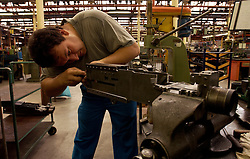 HERSTAL, BELGIUM - JUNE-13-2003 - A large part of the assembly process is done by hand at the FN Herstal weapons fabrication plant near Liege, Belgium. (PHOTO © JOCK FISTICK)