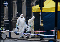 © Licensed to London News Pictures. 23/03/2017. London, UK. Police forensics collect personal belongings from Westminster Bridge, where a car drove  in to the gates of the Houses of Parliament. Yesterday a lone terrorist killed 4 people and injured several more, in an attack using a car and a knife. The attacker managed to gain entry to the grounds of the Houses of Parliament, killing one police officer. Photo credit: Ben Cawthra/LNP