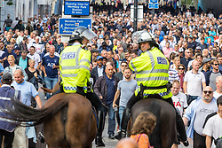 London, August 20 2017. Mounted police keep an eye on the fans as they head towards Wembley Stadium where Tottenham Hotspur host their first game of the Premier League season at their temporary home ground, against ChelseaFC. © Paul Davey.