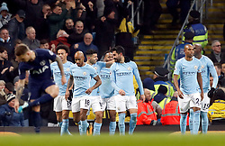 Manchester City's Ilkay Gundogan (centre) celebrates scoring his side's first goal of the game with his team-mates during the Premier League match at the Etihad Stadium, Manchester.