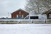 A Police van stationed outside Napier Barracks in the snow, on the 7th of February 2021, Folkestone Kent. The police have been forcing anyone who leaves back inside Napier Barracks due to COVID-19 restrictions, sometimes even carrying them back through the gates.Over 400 asylum seekers are being kept at Napier Barracks in unsuitable, cold accommodation, they are experiencing mental health issues as well as being vulnerable to health conditions including COVID-19. 3 people living inside the barracks have attempted suicide in 2021 already. <br /> (photo by Andrew Aitchison / In pictures via Getty Images)