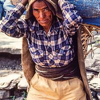 A former Gurkha soldier carries loads for tourist on the around Annapurna trek, Nepal.