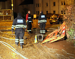 Keswick,Cumbria Monday 7th December 2015 Fire Crews  brought in from the West Midland have spent most of the night and pumping 5 meters of  water away from Booths into a nearby Rugby Pitch,in Keswick to avoid the town  becoming totally flooded again. Pictured  is the damaged store caused by the flooding from Storm Desmond, The aftermath showing  specialist High Volume Pump Operatives pumping water from the flooded  car park into the Rubgy Training ground.©UKNIP<br /> <br /> UKNIP<br /> 07549775333