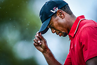 Augusta, GA -- Tiger Woods tips his cap as he walks to the 18th green during the final round of the 2013 The Masters golf tournament at Augusta National Golf Club. -- Photo by Jack Gruber, USA TODAY