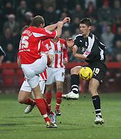 Photo: Mark Stephenson.<br />Cheltenham Town v Bristol City. Coca Cola League 1. 23/12/2006.<br />Cheltenham's Michael Townsend(L) challanges City's Phil Jevons.