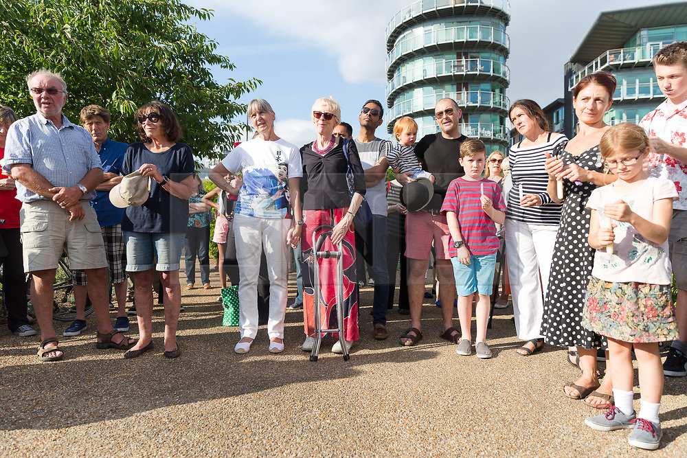 © Licensed to London News Pictures. 16/06/2017. LONDON, UK.  People attending The Great Get Together. Neighbours and friends of Jo Cox attend The Great Get Together near Hermitage Moorings in Wapping to pay tribute and celebrate Jo's call that more unites us than divides us on the anniversary of her death. Jo Cox lived on a house boat in Wapping with her husband Brendan Cox and two children. Photo credit: Vickie Flores/LNP