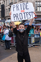 London, June 28th 2014. A gay rights campaigner protests as the Pride London parade proceeds through the city's streets.